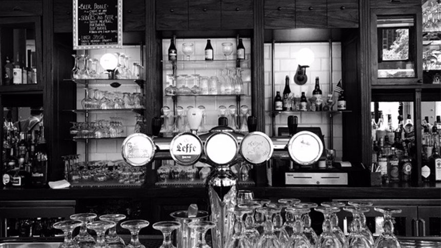 A black and white depiction of the bar front and tap offerings at Belgian Beer Cafe in New York City