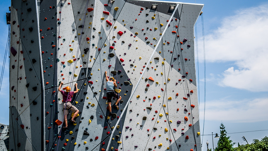 An image of people climbing on the rock wall at Maggie Daley Park