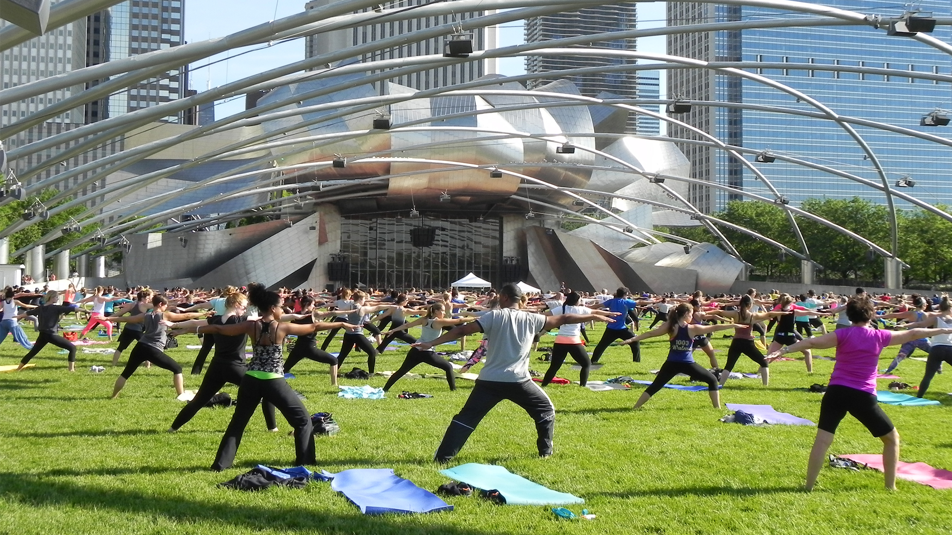 An image of people practicing zumba in Millennium Park in Chicago