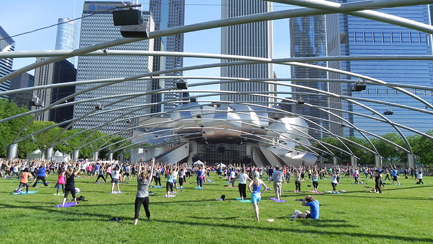 An image of people doing Zumba in Millennium Park in Chicago
