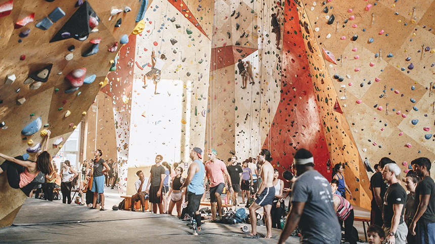 Climbers traverse the rock wall at Brooklyn Boulders in Chicago, IIlinois