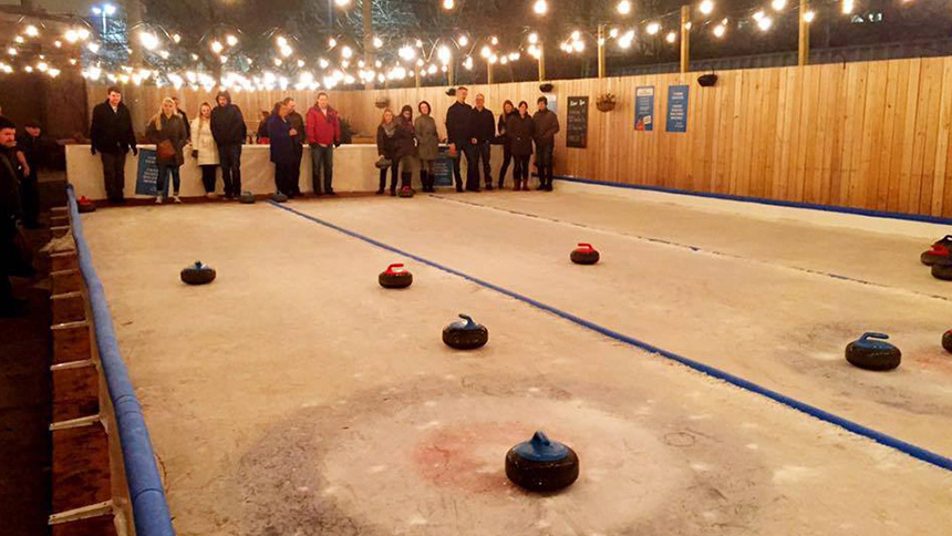 People lining up to participate in ice curling at Kaiser Tiger in Chicago, Illinois