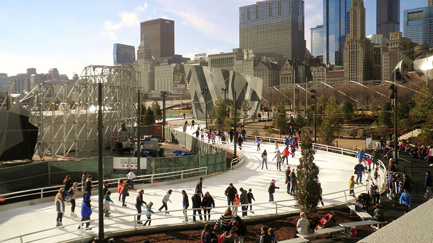 Ice skaters glide on the Skating Ribbon in Maggie Daley Park in Chicago, Illinois