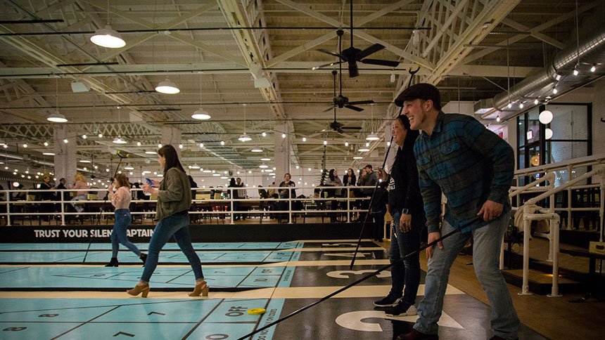 People play shuffleboard at Royal Palms Chicago Shuffleboard in Chicago, Illinois