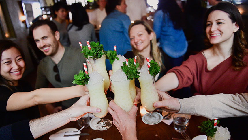 A group toasts at Avital in Hollywood, California