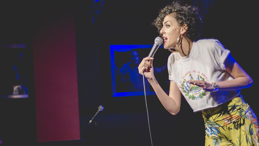 Marcella performing stand-up comedy in Hollywood, California