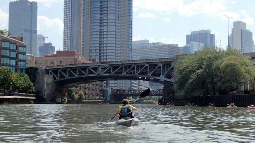 A kayaker paddles the river in Chicago, Illinois