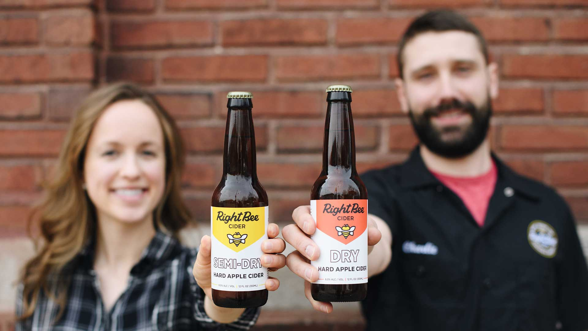 Owners of Right Bee pose with cider bottles